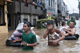 Residents of Malanday town in Marikina City evacuate their homes as the national government raised the alert to critical for low-lying areas in Manila. Weeks of heavy rainfall leaves thousands of people stranded, homeless, and without power.