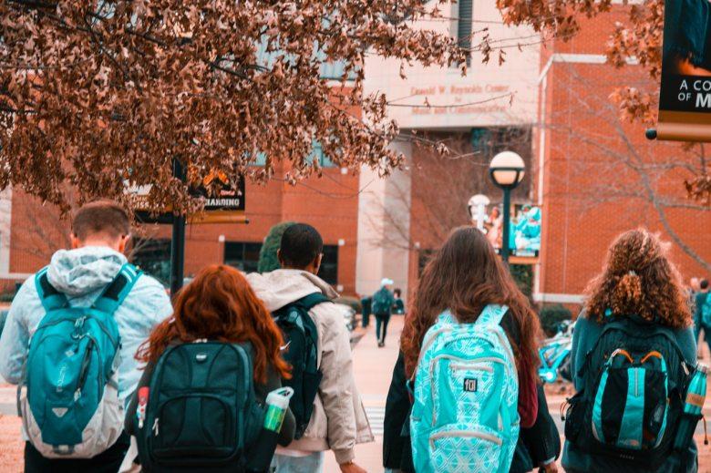 people-wearing-backpacks-1454360