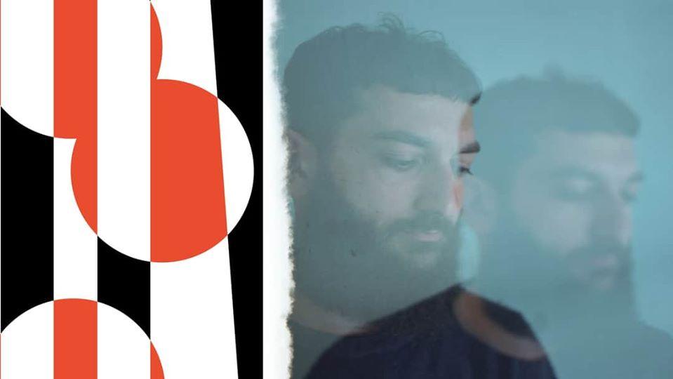 ragazzo-con-barba-cerchi-rosso-nero-bianco