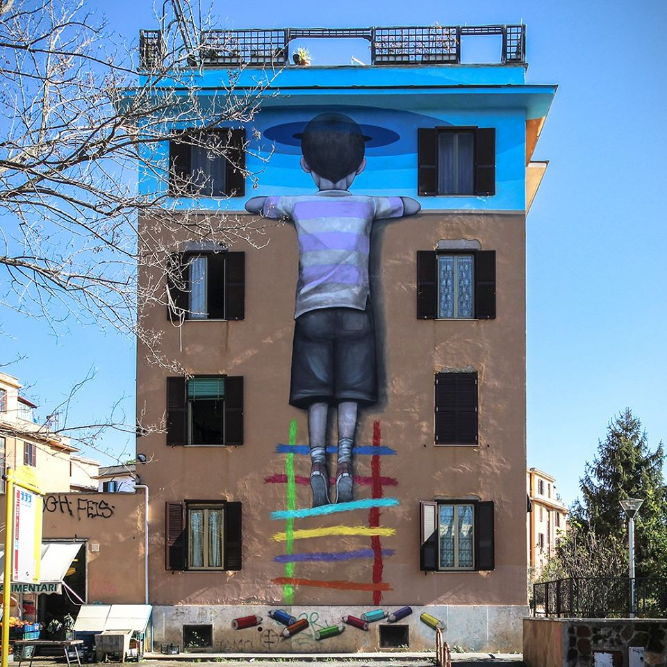 murales-street-art-child-on-a-wall-stairs