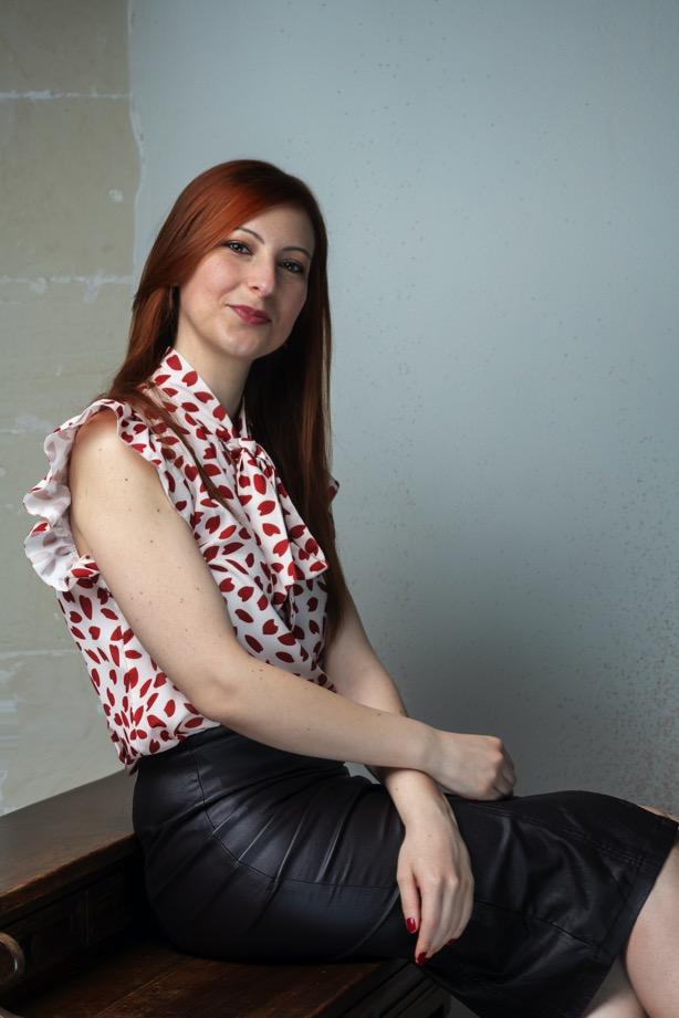 redhead-girl-white-shirt-black-skirt