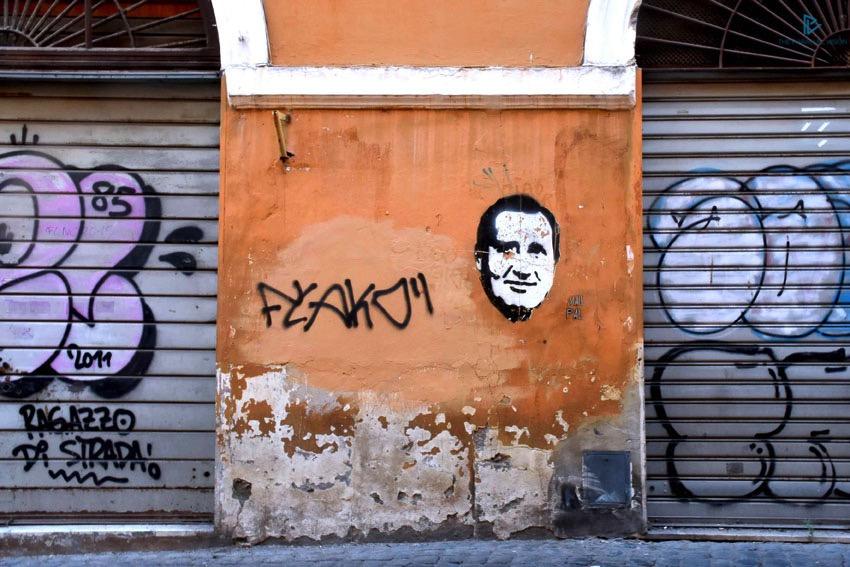 rioni-di-roma-the-parallel-vision-foto-borgo-strade-monumenti-vicoli-street-art-alberto-sordi-murale-saracinesca