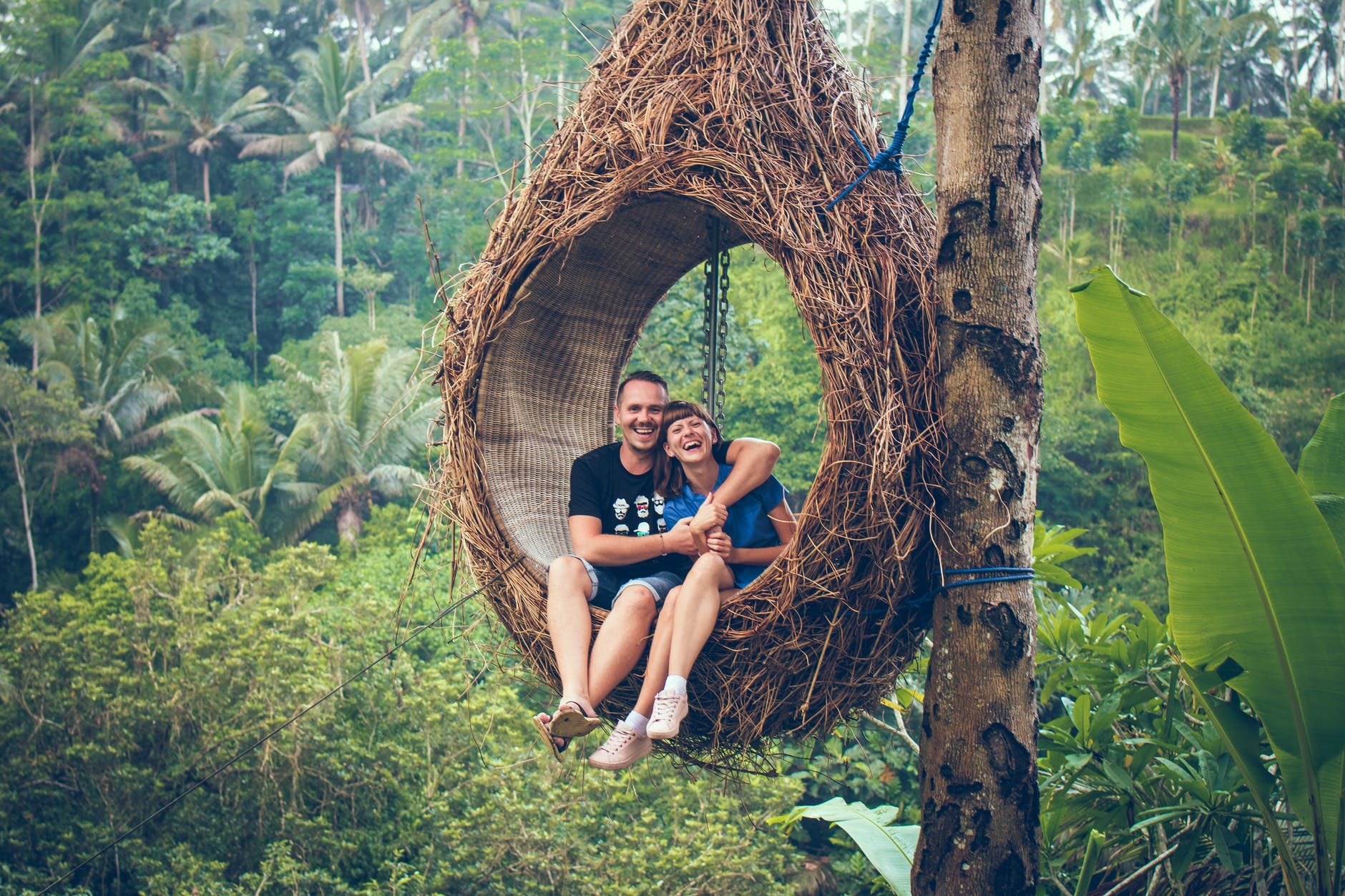 boy-and-girl-in-a-forest-trees-green-relax