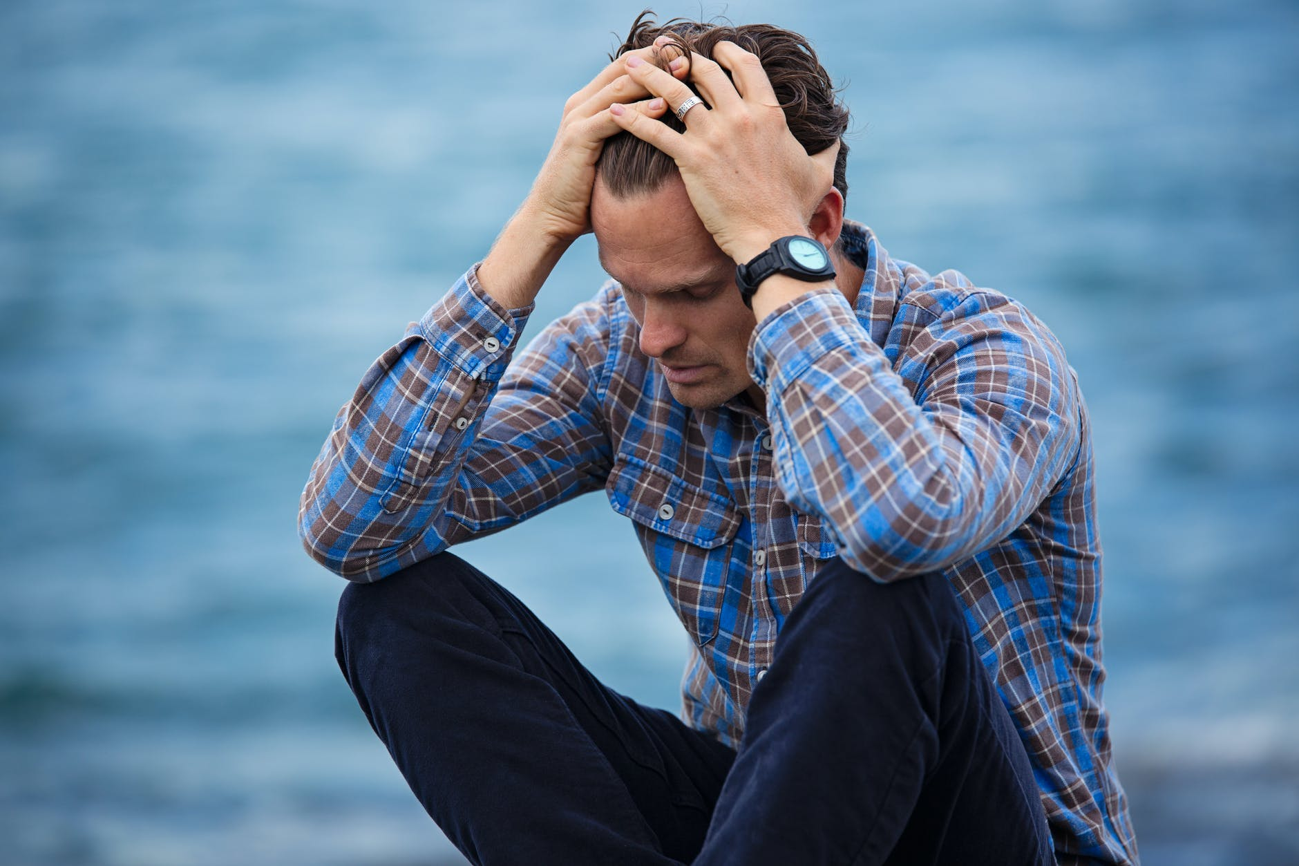 man-alone-sad-shirt-sea-hands