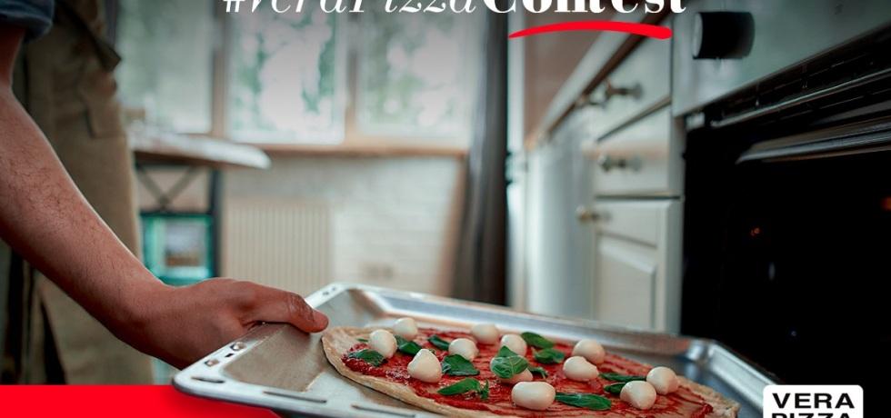 pizza-teglia-mano
