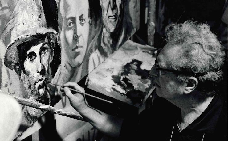 uomo-dipinge-pennello-volti-uomini