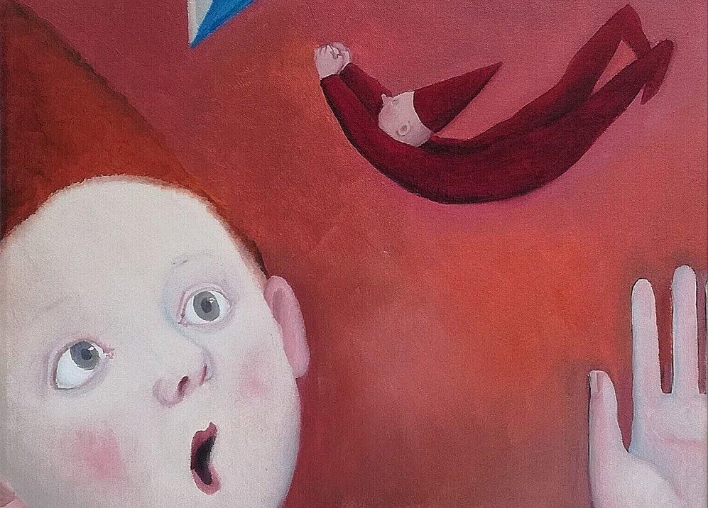 bambino-viso-gnomo-volante-mano